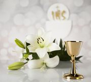 Holy communion a golden chalice with grapes and bread wafers. Eucharist, sacrament of communion background stock photography