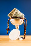 Holy communion and money Royalty Free Stock Images