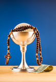 Holy communion and money Stock Photos