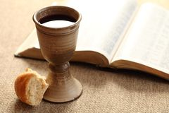 Holy communion. Communion still life - wine, bread and Bible Stock Photo