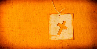 Holy cross. Close up of handmade paper tag with holy cross Royalty Free Stock Photo