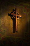 The Holy Cross. Wooden cross bathed in golden ray of light Stock Images