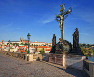 Holy cross at Calvary, view of the Cathedral of St. Vitus. Stock Photo