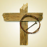 Holy Cross, crown of thorns and nail. The Holy Cross, the crown of thorns and a nail depicting the passion of Jesus Christ on a beige background, with a retro Royalty Free Stock Images