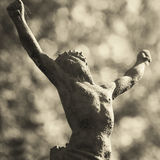Holy cross with crucified Jesus Christ Antique statue religio Royalty Free Stock Photo