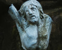 Holy cross with crucified Jesus Christ  (fragment of ancient sta Stock Photography