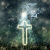 Holy Cross glowing, bright moon on dark sky, dark clouds Royalty Free Stock Photography
