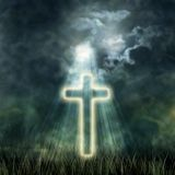 Holy Cross glowing, bright moon on dark sky, the dark clouds Royalty Free Stock Photo