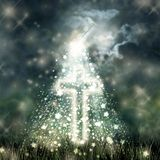Holy Cross glowing, bright moon on dark sky, dark clouds Royalty Free Stock Photos
