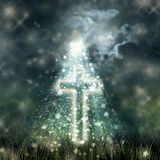 Holy Cross glowing, bright moon on dark sky, dark clouds Royalty Free Stock Image