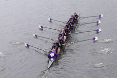 Holy Cross Women's Crew races in the Head of Charles Regatta Women's Master Eights Royalty Free Stock Photo