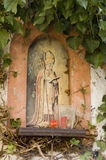 Holy decoration on a wall. In Italy Stock Photos