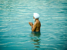 Holy dip at Golden Temple stock images