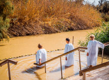 Holy dip in the river Jordan. Bethany city, Jordan - August 09, 2016:biblical baptism site of Jesus Christ. Pilgrims perform ritual ablutions in the sacred river Stock Photography