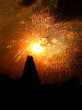 Holy Diwali. Fireworks bursting in the evening sky against the silhouette of a temple in India, on the occassion of Diwali festival