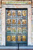The Holy Door is the northern entrance at St. Peter's Basilica Stock Photo