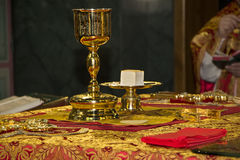 Holy Eucharist in orthodox church. Consecrated bread and wine in chalice on Holy See, during orthodox liturgy on Easter, 2016 year. Trinity Cathedral in royalty free stock image