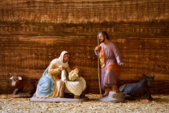 The holy family in a rustic nativity scene. The holy family, Child Jesus, the Virgin Mary and Saint Joseph, and the donkey and the ox in a rustic nativity scene royalty free stock image