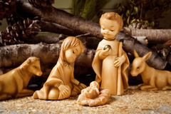 The holy family in a rustic nativity scene. The holy family, the Child Jesus, the Virgin Mary and Saint Joseph, and the donkey and the ox in a rustic nativity royalty free stock photo