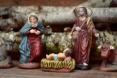 The holy family in a rustic nativity scene. The holy family, the Child Jesus, the Virgin Mary and Saint Joseph, and the donkey and the ox in a rustic nativity stock photography