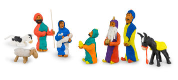 Holy family and three kings. Done manually by a child, colorful figures from the modeling, showing the holy family and the three kings Stock Images