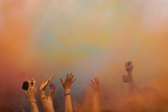 Holi fest. People's hand in the air on Holi fest stock photos