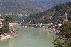 Holy Ganges river that flows through Rishikesh (the world capital of Yoga) - the holy city for the Hindus, India. Royalty Free Stock Photo