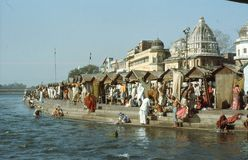 1977. India. A holy ghat, at the banks of Ganges. The picture shows a holy ghat where the Hindu pilgrims are doing their praying Royalty Free Stock Photos