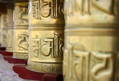 Holy golden praying wheels Stock Image