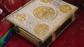 The holy gospel is covered with gold