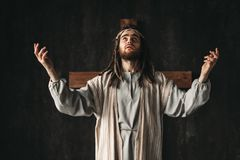 Great martyr praying, cross on black background. Holy great martyr praying, cross on black background. Prayer against crucifixion of Jesus Christ, christianity Royalty Free Stock Photos