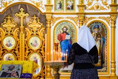 A praying woman in an Orthodox Christian church in the village of Holy Hand, Krasnodar Territory. royalty free stock photos