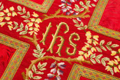 Holy IHS on vestment Royalty Free Stock Photo