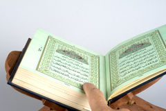 Holy islamic book Koran opened Royalty Free Stock Image
