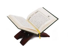 Holy islamic book Koran opened and isolated Royalty Free Stock Image