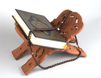 Holy Islamic book Koran Quran closed with rosary Royalty Free Stock Photography