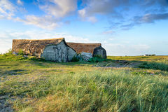 Holy Island Boat Sheds. Beautiful boat sheds made form upturned boats at Lindisfarne off the coast of Northumberland Stock Images