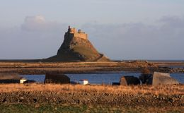 Holy island castle Stock Photos