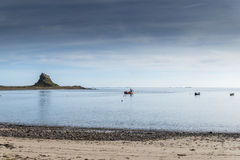 Holy Island castle. A view of Holy Island castle from beach on a summers day Stock Photos