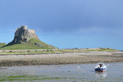 Holy Island Lindesfarne. Holy Island Castle with a boat in the foreground. Photo taken April 2015 Royalty Free Stock Images