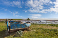 Holy Island. Lindisfarne Castle with an Old Boat in the Foreground in Northumberland, UK Royalty Free Stock Image