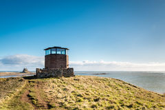 Holy Island Lookout Tower. The former Coastguards Lookout Tower on Holy Island off the Northumberland coastline Stock Photo