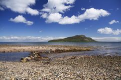 Holy isle. Just off an Arran Beach in Scotland royalty free stock image