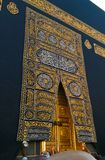 Holy Kaaba door in the holy mosque during tawaf when umra stock photography