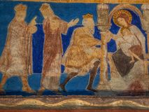 The holy kings bring their gifts to the Christ child. A romanesque wall-painting in Bjaresjo church, Sweden, November 6, 2009 Stock Photography