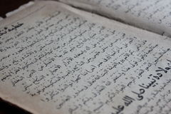 Holy Koran. Pages of Holy Koran with black writing Stock Photos