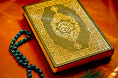 Holy koran. Muslim holy Koran book with wooden rosary Royalty Free Stock Photos