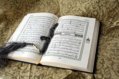 Holy koran. Book open & rosary Royalty Free Stock Photography