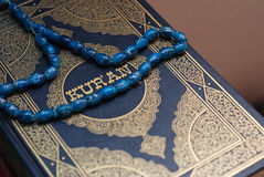 Holy Koran. And bead close up Royalty Free Stock Photo