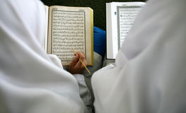 Holy Koran. Reciting Islam holy book of Koran stock image